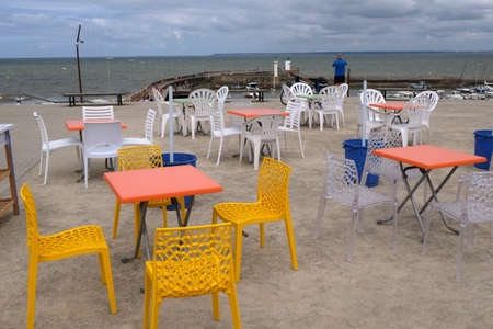 Colorful chairs on a cafe terrace in Saint-Michel-Chef-Chef