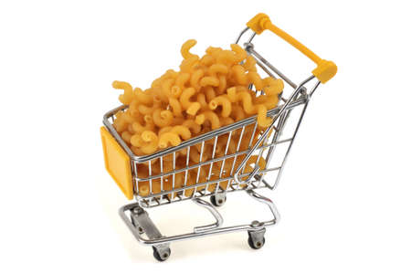 Supermarket trolley filled with pasta close-up on white background Stockfoto