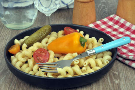 Plate of pasta with vegetables close-up