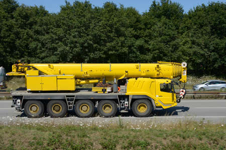 Crane truck driving on a fast track in Vannes in Brittany