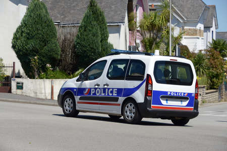 Police car driving in a street of Vannes in Brittany