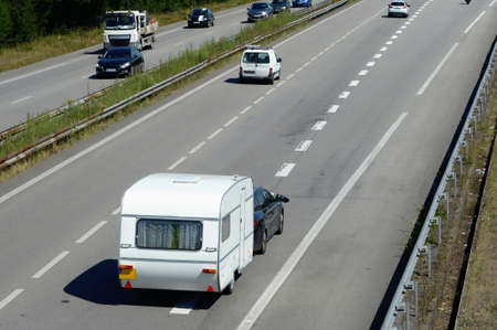 Caravan traveling on a fast track in Vannes in Brittany