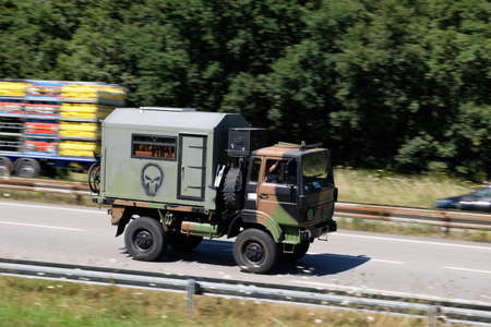 Military decontamination truck driving on an expressway in Vannes in Brittany