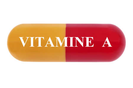 Concept of dietary supplement with vitamin A capsule close-up on white background