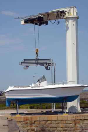 Launching a motor boat with a harbor crane