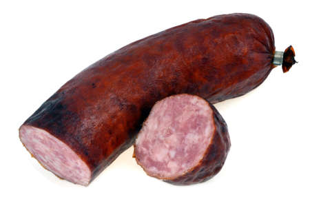 Garlic sausage cut in close-up on white background