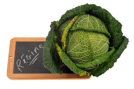 Green cabbage with a school slate on which is written diet in French