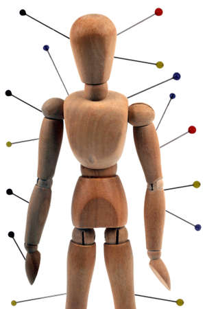 Acupuncture concept with wooden mannequin on white background