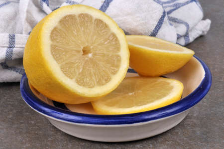 Lemon sliced in a saucer close up