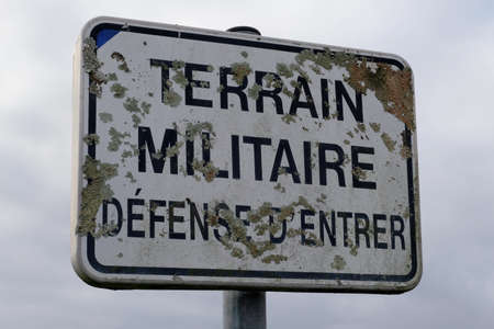 Sign indicating military land with no entry