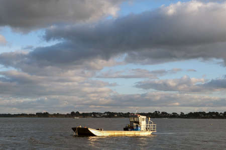 Oyster barge moored off Locmariaquer in the Gulf of Morbihan in Brittany