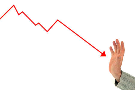 Financial crisis concept with a hand trying to stop falling prices on the graph