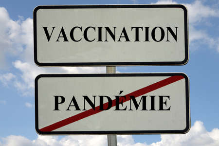 French pandemic vaccination incentive concept with a road traffic sign Standard-Bild