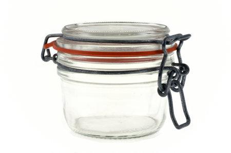 Glass jar close-up on white background