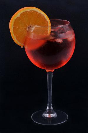 Glass of spritz with a slice of orange close-up on black background Standard-Bild