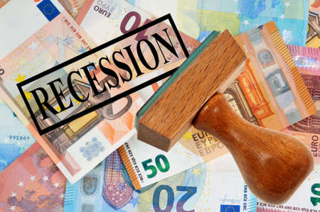 Ink pad indicating recession on euro banknotes background