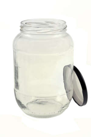 Empty jar with its lid close-up on white background
