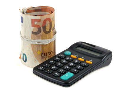 Roll of euro banknotes next to a calculator on a white background Standard-Bild