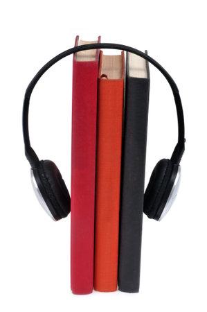Audiobook concept with headphones holding novels on white background Standard-Bild