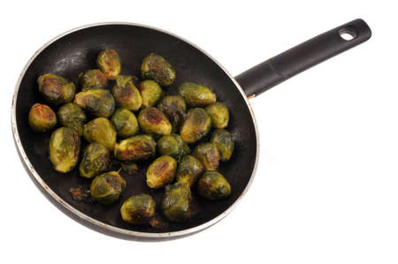 Brussels sprouts cooked in a pan close-up on white background