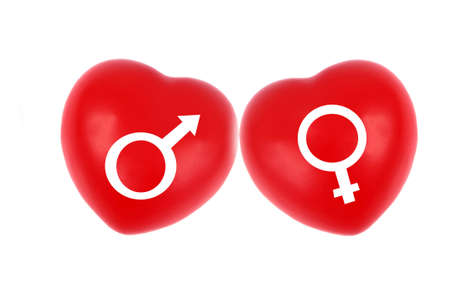 Two hearts with female and male symbols close up on white background