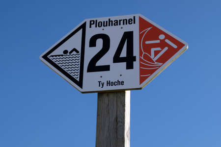 Close-up of a sign on Ty Hoche beach in Plouharnel indicating the sides reserved for swimmers and surfers Reklamní fotografie