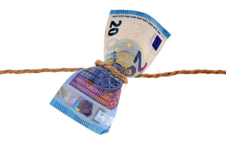 Concept of financial crisis with twenty euro banknote tied with string close up on white background