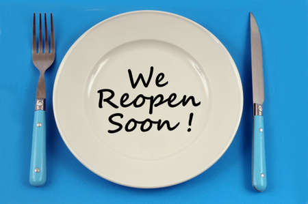 Plate on a blue background in which is written we reopen soon
