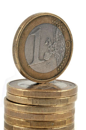 Stack of euro coins close-up on bench background | Pile of pi