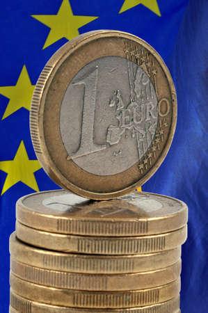 Stack of euro coins on European flag background Stock Photo