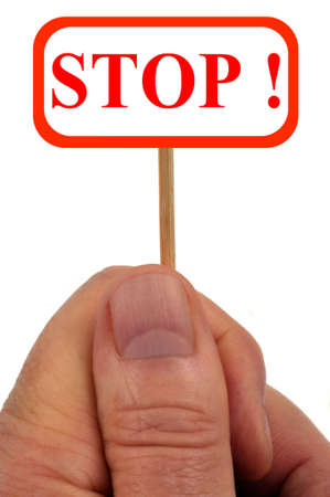 Hand holding a sign with stop written on it Stock Photo