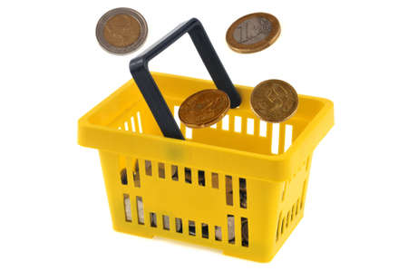 Concept of purchasing power with yellow plastic shopping cart and euro coins on white background Stock Photo