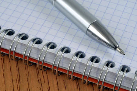 Pen on a spiral notebook close-up Stock Photo