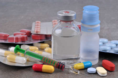 Close-up medical treatment with various drugs and syringe