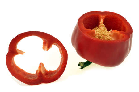 Raw red bell pepper cut in close-up on white background Imagens