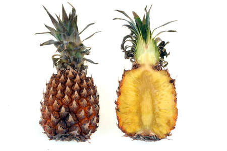Pineapple cut in half close-up on white background Banque d'images