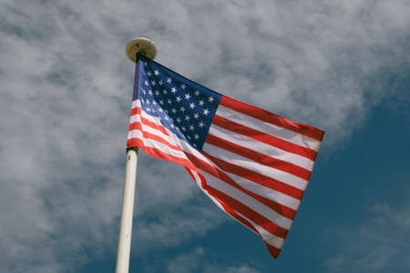 United States flag close-up on blue sky background