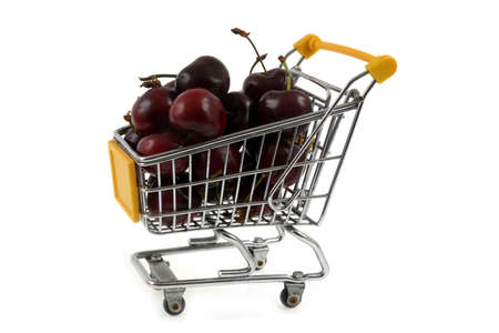 Bigarreaux cherries in a supermarket trolley close-up on a white background