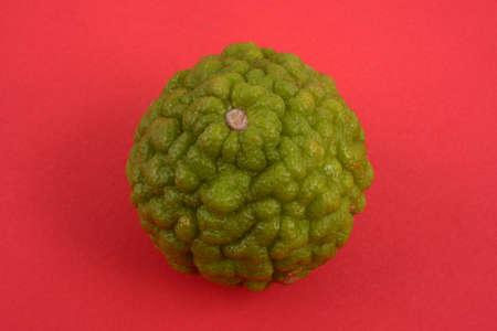 Kaffir lime lemon close-up on black background