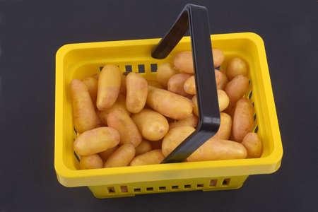 Basket of potatoes close-up on black background