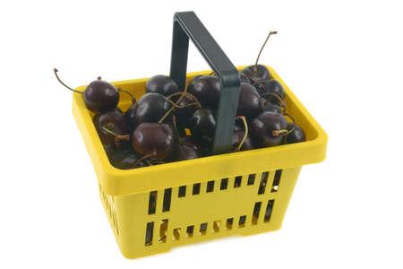 Basket of bigarreau cherries close-up on white background