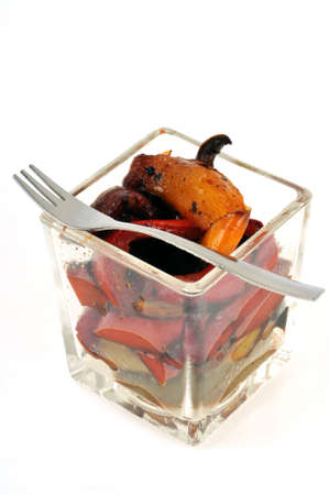 Verrine of candied peppers with fork close-up on white background Banque d'images