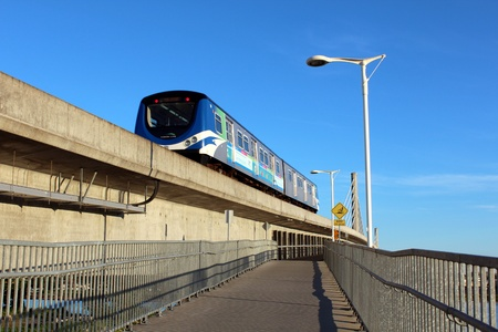A Skytrain leaves Richmond for Vancouver, BC