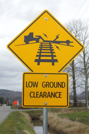 danger ahead: Low Ground Clearance Signage Stock Photo
