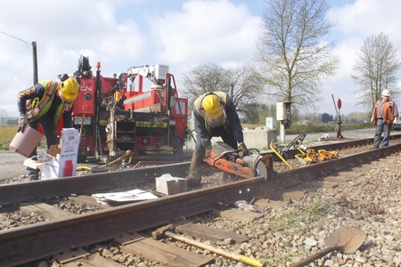 Crew Repairs Railroad Track