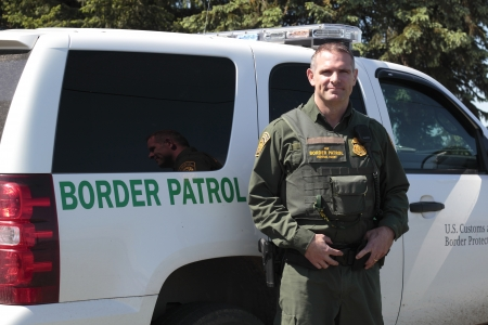 border patrol: United States Border Patrol Officer and Vehicle Editorial