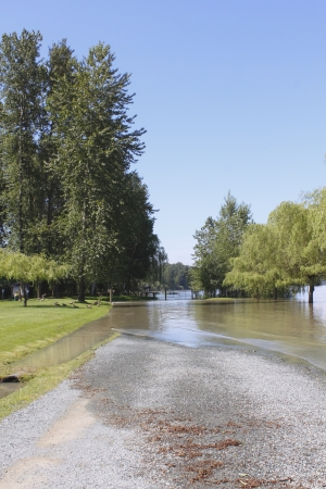 A river has flooded a rural road