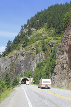 Vehicles and campers drive into a tunnel in British Columbia s beautiful Rockies Stock Photo - 14133902