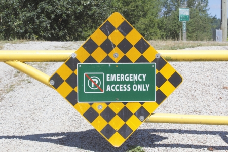 proceed: A sign warns motorists that only emergency vehicles are allowed on the dike