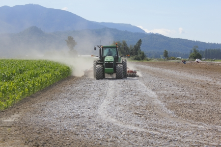 Lime is spread on a field to enrich the soil
